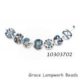 10303702 - Seven Ivory w/Blue Strips Lentil Beads