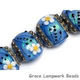 10414212 - Four Arctic Blue Florals Lentil Beads