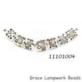 11101004 - Seven Ivory w/Beige Stringer Pillow Beads